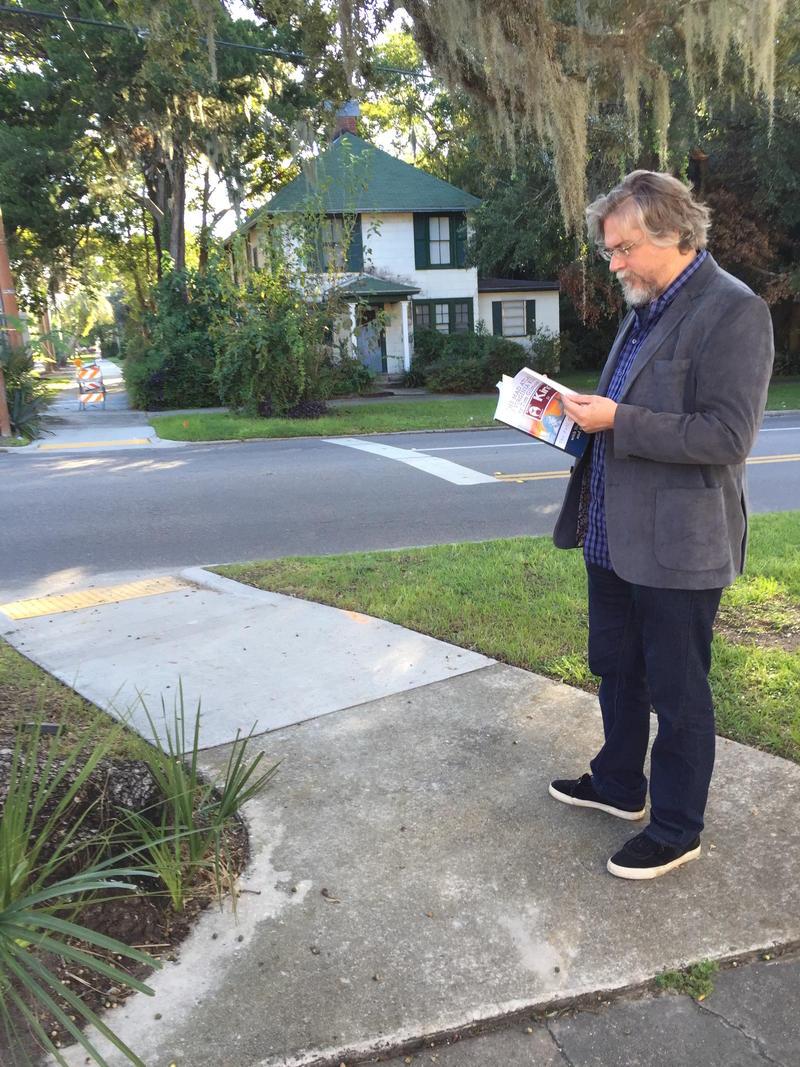 Gilmore standing on corner