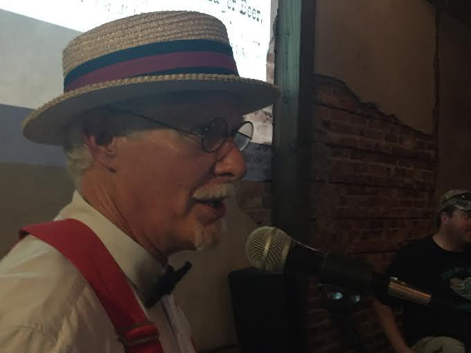 Jacksonville Historical Society's Wayne Wood dons suspenders, a bow tie and a straw hat to transform into Jax Brewing Co. founder William Ostner.