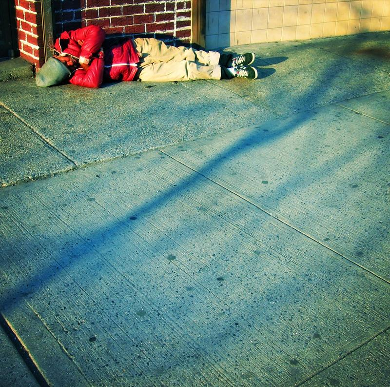 homeless man on sidewalk