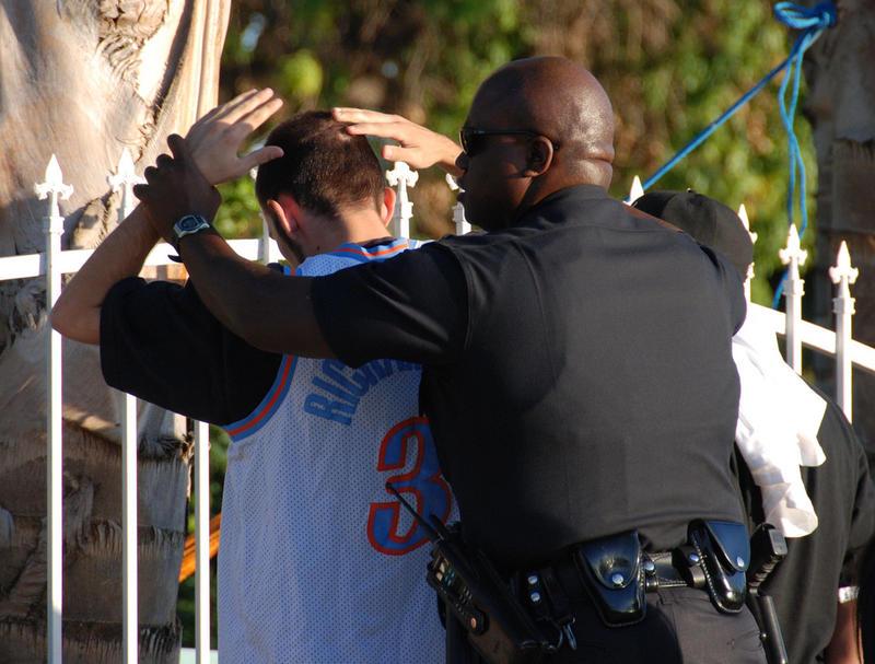 young man under arrest