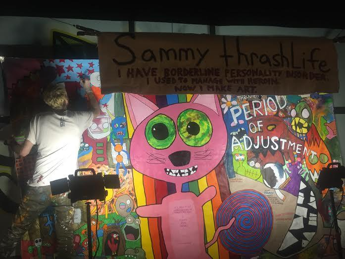 Sammy thrashLife seldom takes breaks while painting his mural. Here, he makes some adjustments to his work Wednesday night in Five Points.
