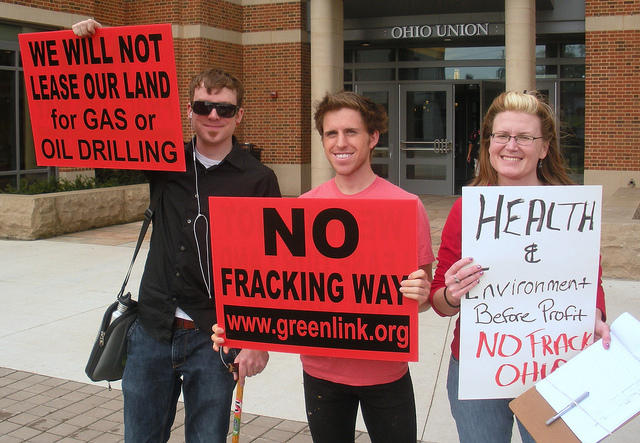 "protesters holding ""no fracking way"" signs"