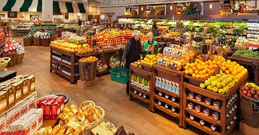 shoppers in Fresh Market produce section