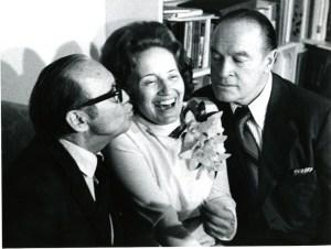 (C) Kinne enjoys the attentions of BFF's (L) Jack Benny and (R) Bob Hope.