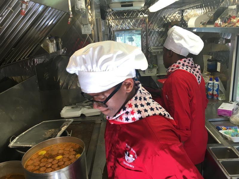 Duval's Chop Chef food truck team preps a shrimp boil, Monday.