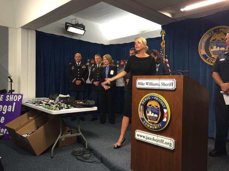 Attorney General Pam Bondi gestures to synthetic drugs siezed in the raid Thursday.