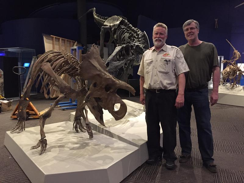 Paleontologist Mike Triebold (left) and co-curator Angus Carroll (right) pose next to