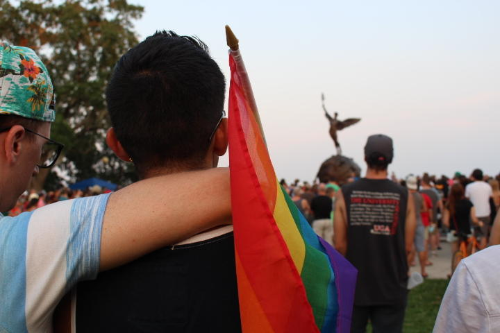 Hundreds of Jacksonville residents gather in Riverside's Memorial Park Sunday night to honor and mourn the victims of a mass shooting early Sunday morning at the gay night club Pulse in Orlando.
