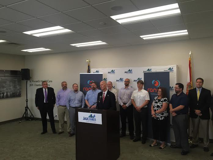 Florida Governor Rick Scott helps announce the development of a new app in Jacksonville.