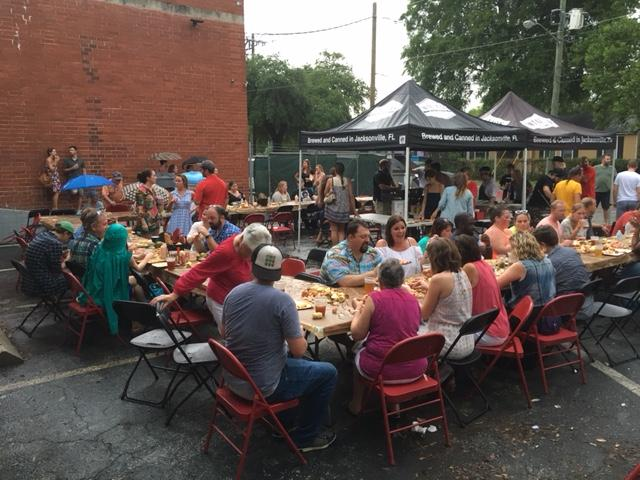 Diners eat at the first-ever Sunday Supper event, held by Edible Northeast Florida at Intuition Ale Works