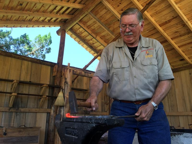 Fountain of Youth blacksmith Greg Sikes works in the park's new shop