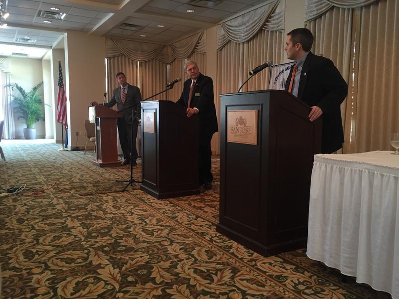 Kent Justice (far left) moderates a debate between Dick Kravitz (center) and Jason Fischer at the San Jose Country Club.