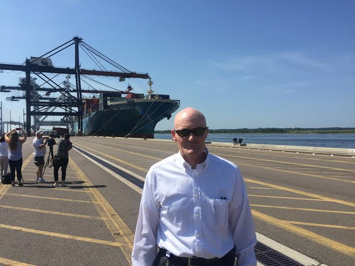 JAXPORT CEO Brian Taylor stands in front of the MOL Majesty, the first ship through the new Panama Canal.