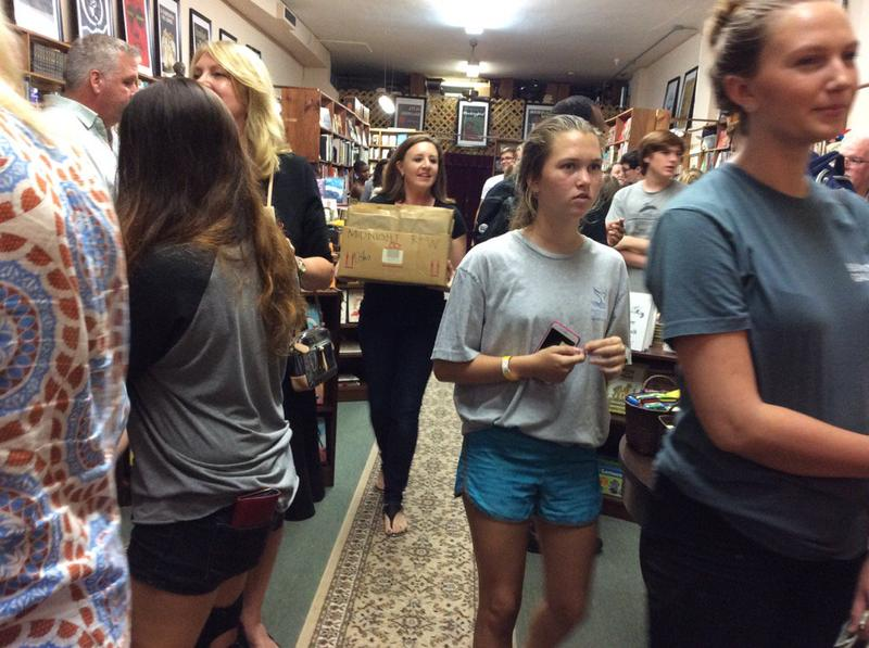 "San Marco Books co-owner Desiree Bailey delivers a box of ""Harry Potter and the Cursed Child"" books to waiting customers on Sunday, July 31."