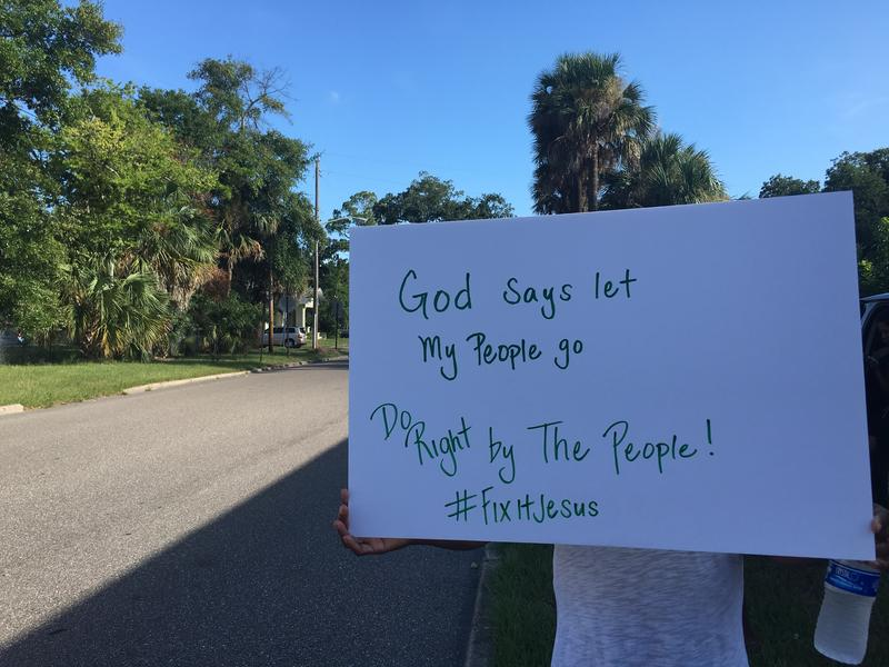 Residents of the Northside's Fairway Oaks neighborhood protested outside of HabiJax Friday morning.