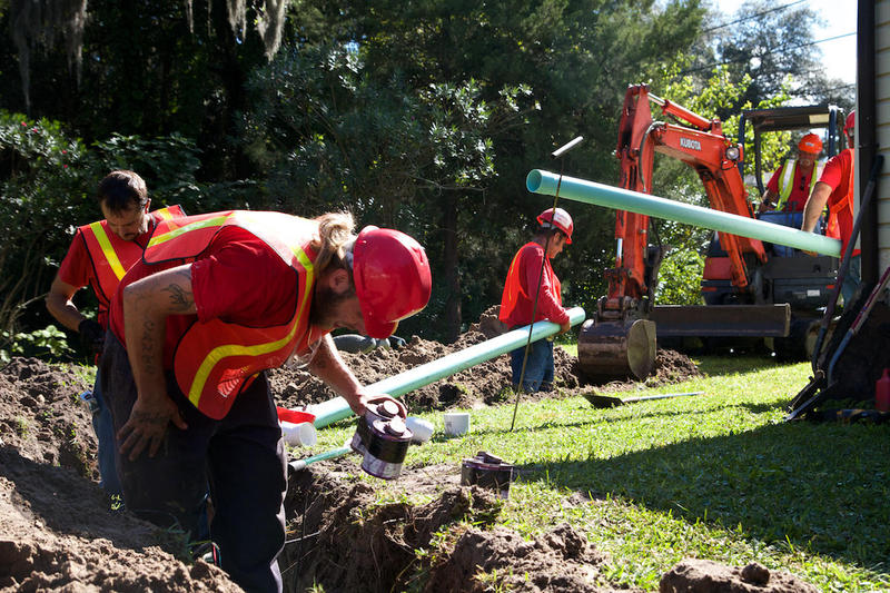 JEA workers connect a home to a sewer line in 2014.