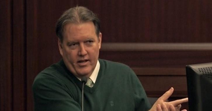 Dunn testifies during a trial in Jacksonville.