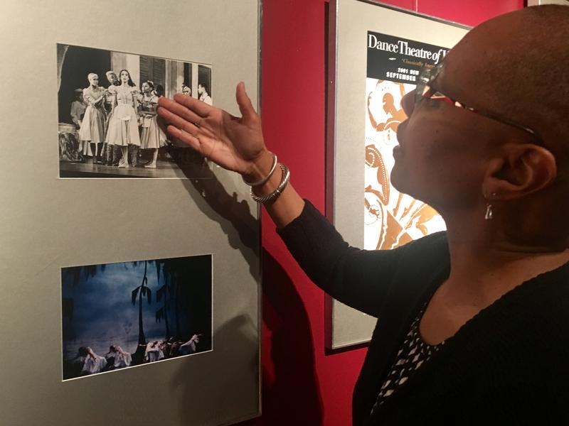 Anjali Austin, a former Harlem company dancer is pointing to a cast photo she's in hanging on the Ritz' wall.