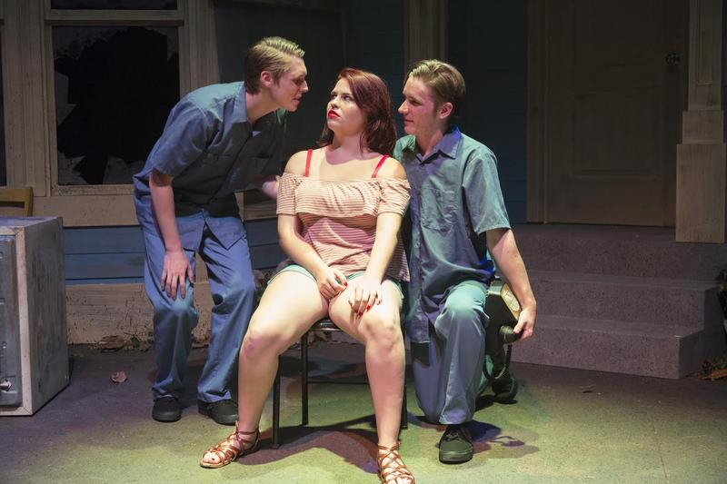 Two of Ottis Toole's personalities clash with another character on stage.