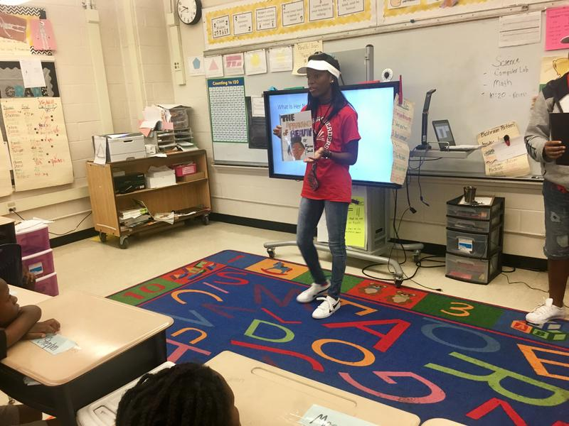 """Kirby Smith 13-year-old Keena Small shared her book , """"The Appearance of Beauty,"""" with a class of second graders, Tuesday."""