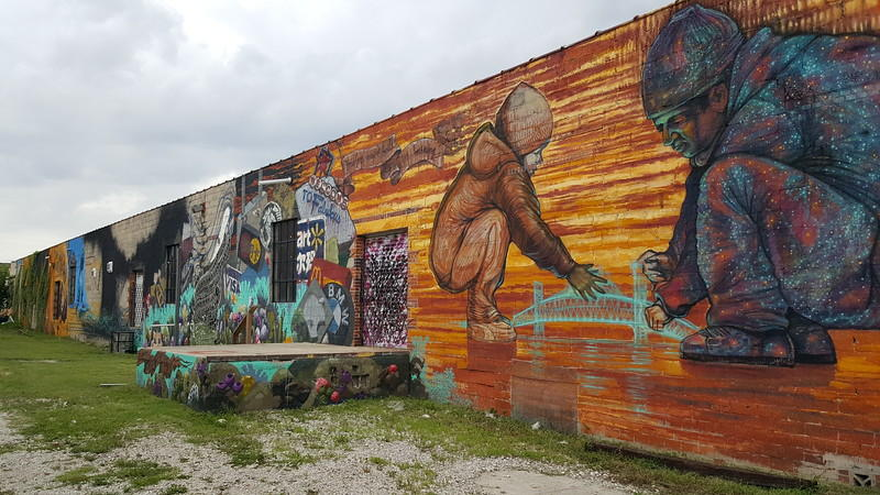 large colorful mural on warehouse