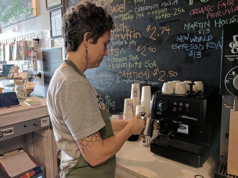 Siddie Friar making an espresso for a customer at Coniferous Cafe.