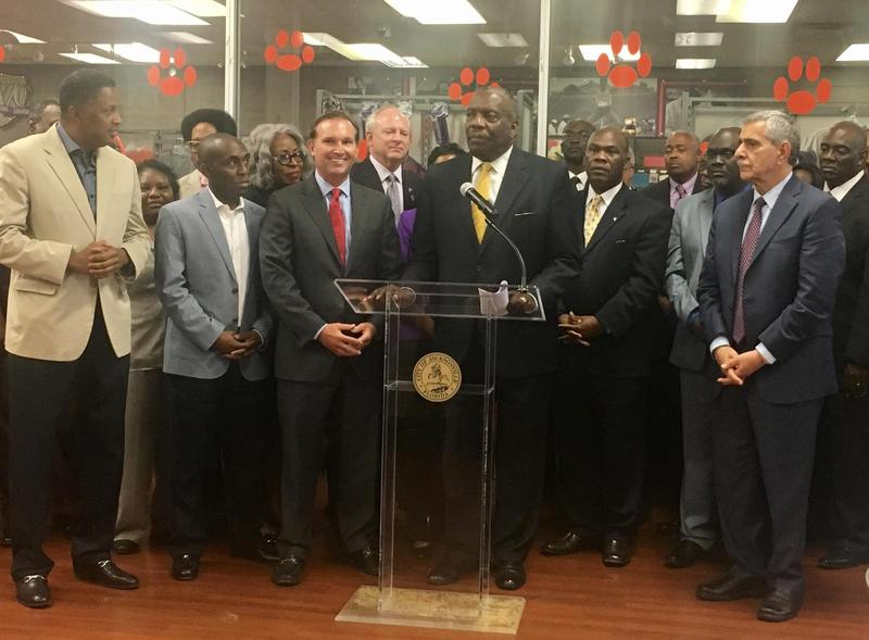 Edward Waters College President Nat Glover and Jacksonville Mayor Lenny Curry, surrounded by several City Council members,  announced a more than $8 million proposed investment in the college.