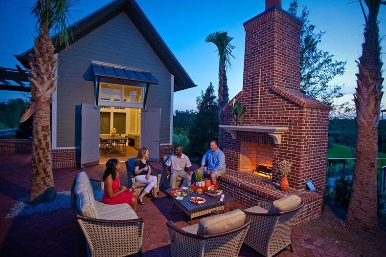 people sitting around backyard firepit