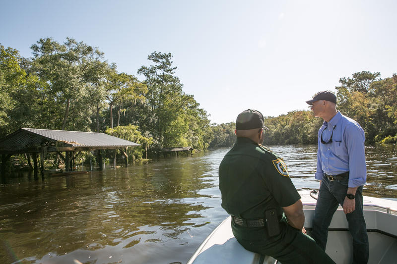 Florida Governor Rick Scott and Clay County Sheriff Darryl Daniels survey Black Creek flooding Wednesday.