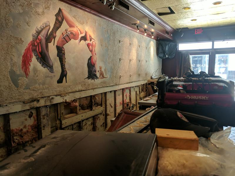 Dos Gatos' iconic bar has been gutted after flood waters tore into the lounge Sunday night.