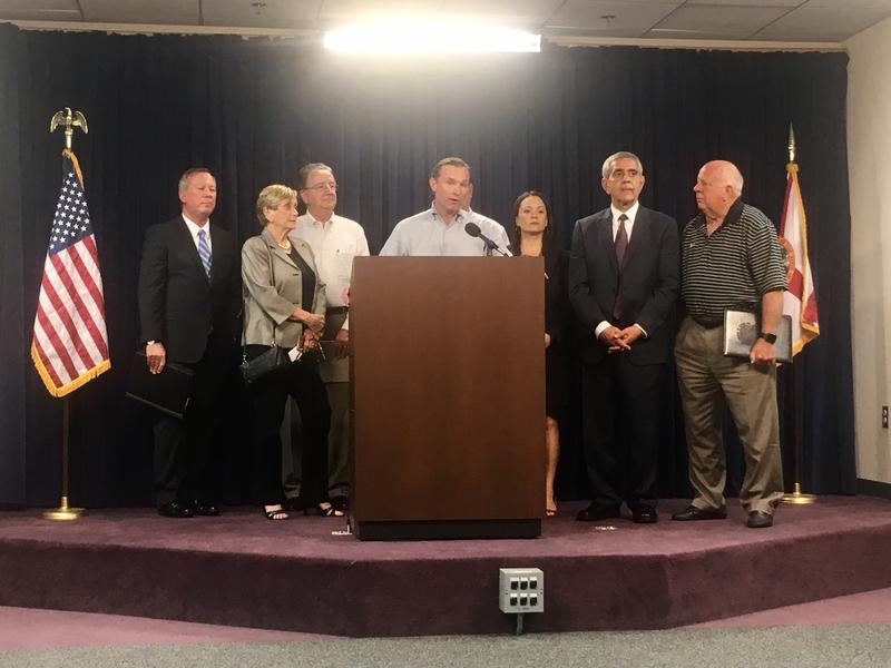 Jacksonville Mayor Lenny Curry and other officials speak about hurricane preparation, Tuesday.