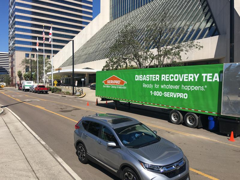 A Servpro trailer is pictured outside the Wells Fargo Center on Tuesday as the tower reopened for business.