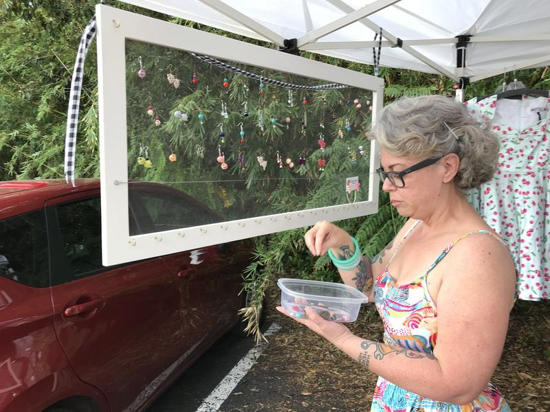 Grease Rags proprietress Cindy Platt sells earrings as part of a #SanMarcoStrong benefit on Sept. 23. Hers is one of the shops raising money for less fortunate neighbors.