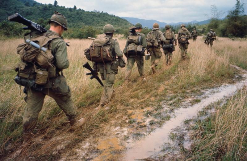 soldiers march in Vietnam