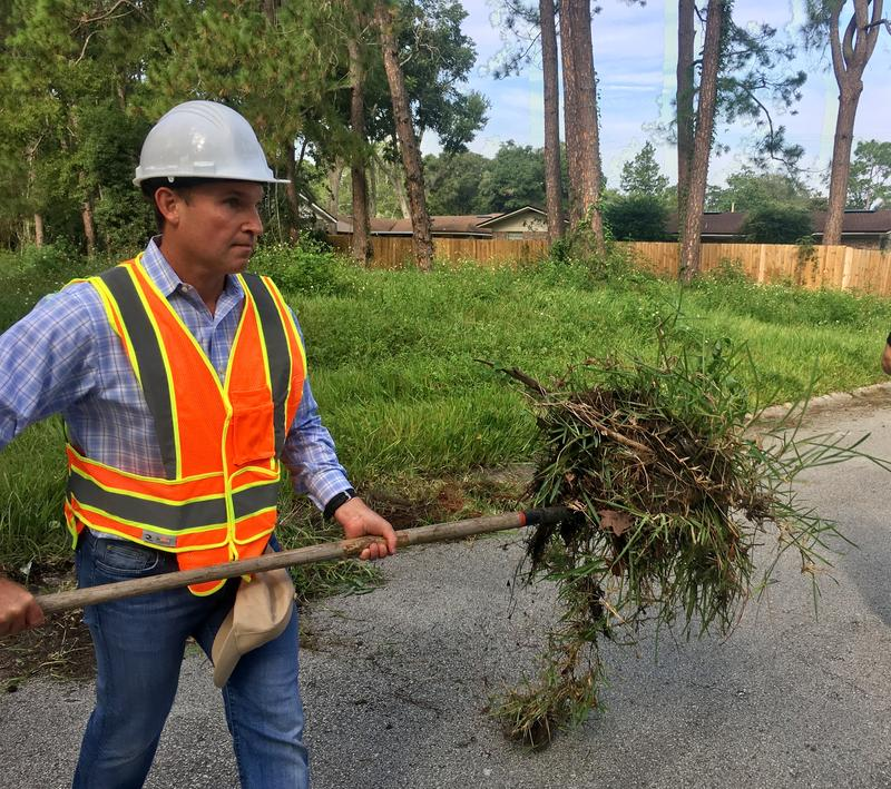 Mayor Lenny Curry helps Public Works crews clear storm drains in Mandarin on Sept. 7.