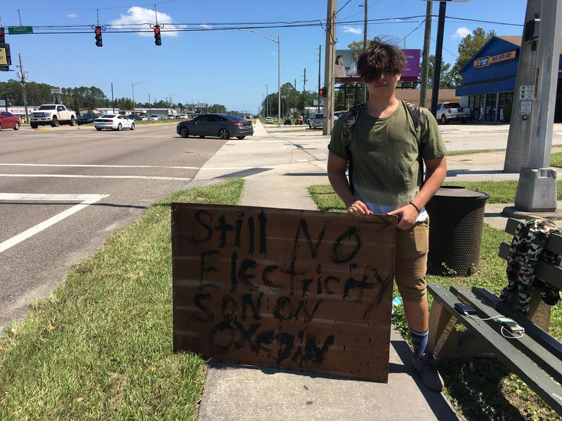 Thirteen-year old Dantae Luhouse tries public shaming to get JEA to restore power to his neighbors on Peach Drive off of Beach Boulevard.