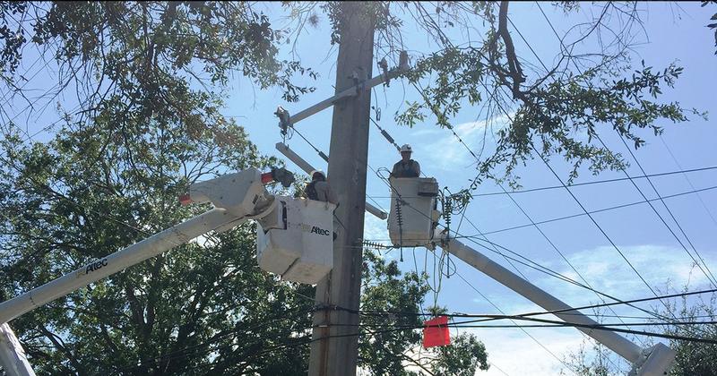 A JEA crew restores power.
