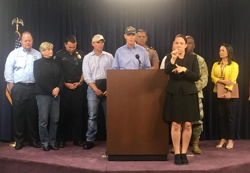 Governor Rick Scott delievers storm updates along side Jacksonville city officials Thursday.