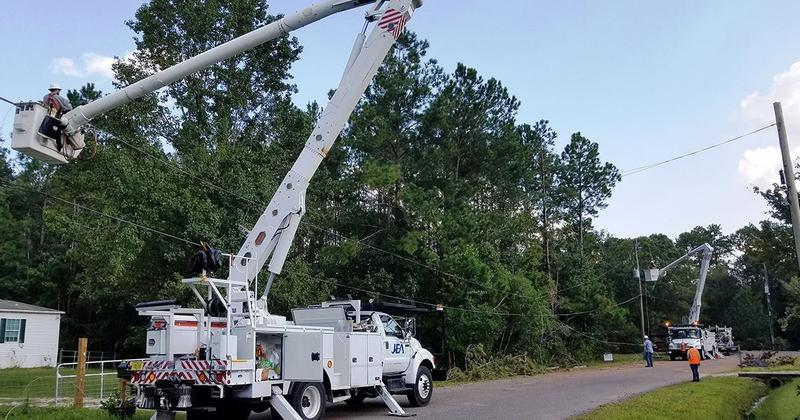 Crews are seen in this photo working to restore power to customers on Clear Creek Ct. in Jacksonville.