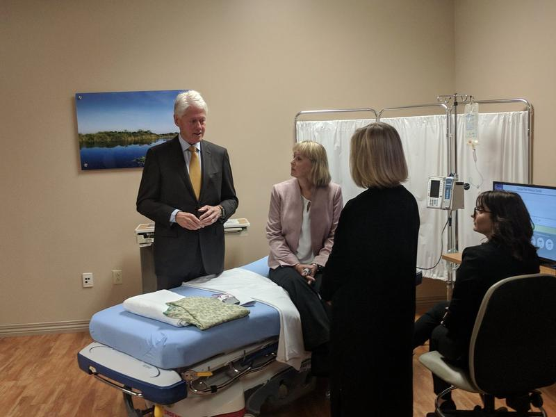 Former President Bill Clinton is told about an addicition assessment tool Tuesday morning at the Orange Park Medical Center.
