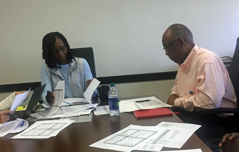 Board Chair Paula Wright and board member Warren Jones met to talk about the next step in choosing a search firm.