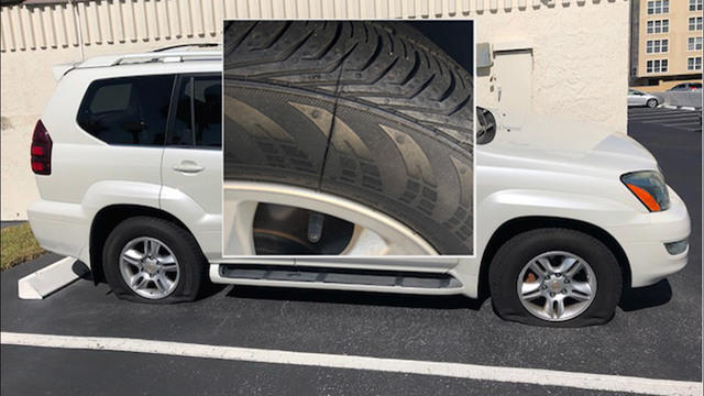 A motorist's slashed tire in Jacksonville Beach is pictured.