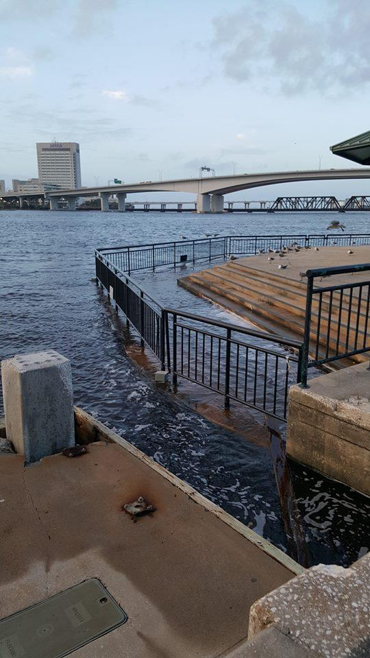 The St. Johns River overflows onto a Northbank pavilion in downtown Jacksonville Thursday morning.