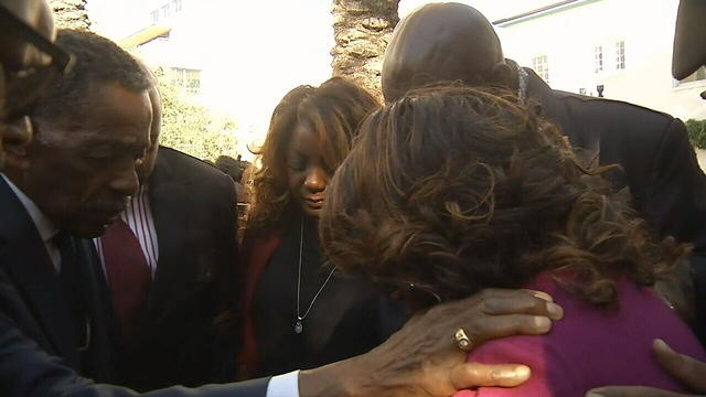 Former U.S. Rep. Corrine Brown joins in a prayer circle before her sentencing hearing Thursday morning.