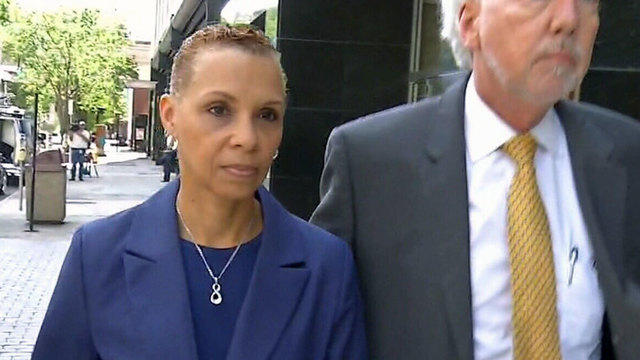 Carla Wiley leaves U.S. District Courthouse with her attorney after testimony Monday morning.