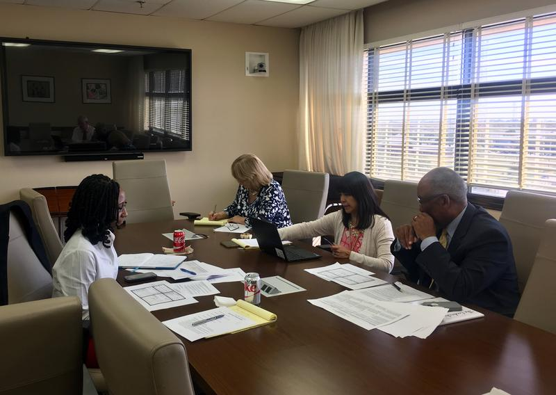 Duval School Board Chair Paula Wright, board member Warren Jones and distrct staff members discuss the RFP for potential superintendent search firms.