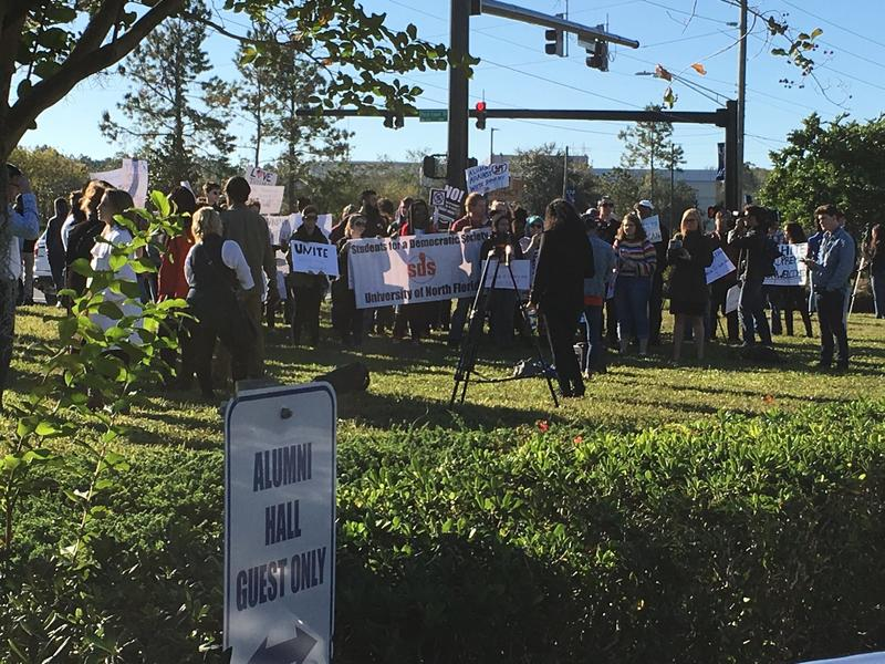 Students for a Democratic Society (SDS) were among those protesting outside UNF's Alumni Hall on Kernan Boulevard.