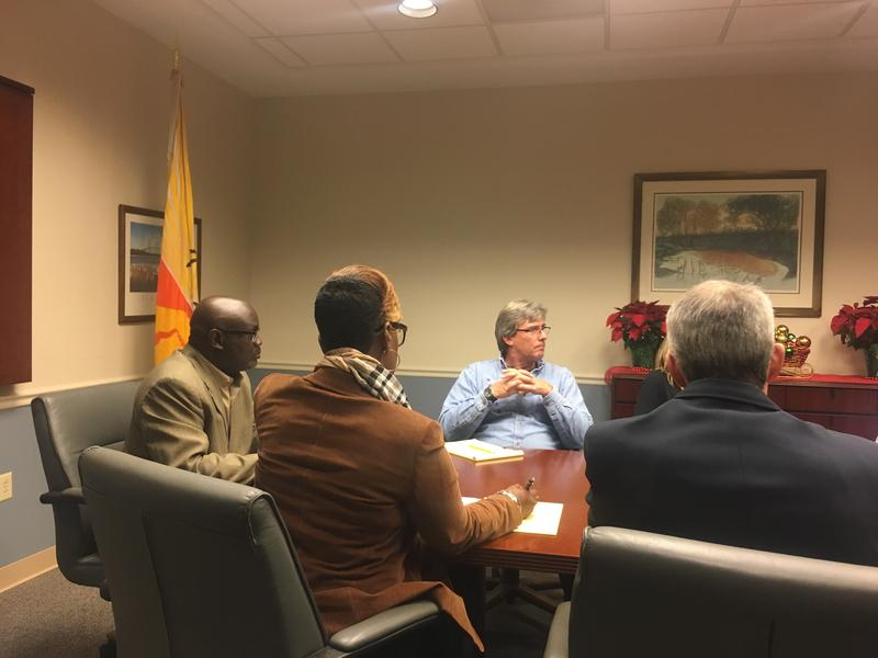 Councilmembers Sam Newby (far left) and Al Ferraro meet with JTA representatives.