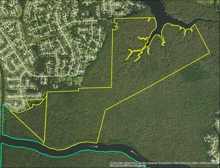 The donated property area is outlined in yellow in this arial map.