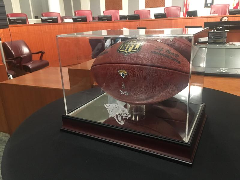 A football from the Jaguars' playoff win against the Bills was displayed in city council chambers.